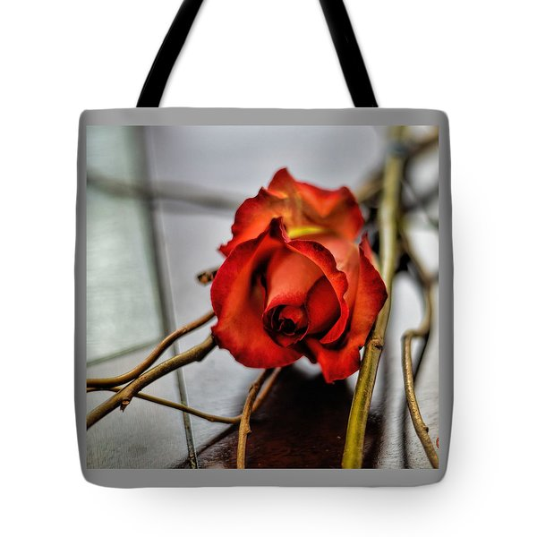 Tote Bag featuring the photograph A Rose On Bamboo by Diana Mary Sharpton