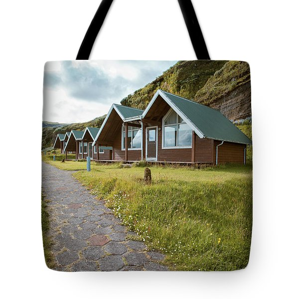 Tote Bag featuring the photograph A Row Of Cabins In Iceland by Edward Fielding