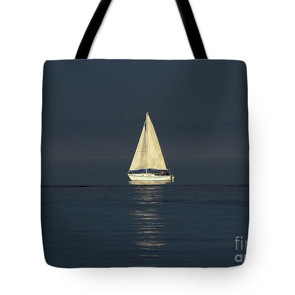 A Sailboat Capturing Light Tote Bag