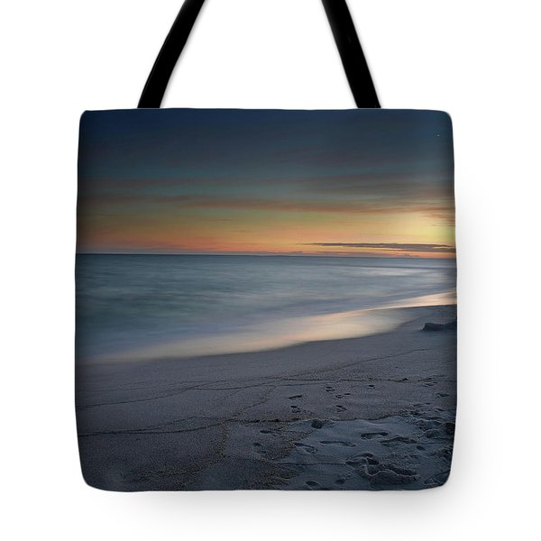 A Sandy Shoreline At Sunset Tote Bag