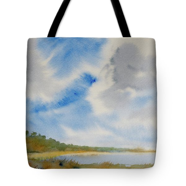 A Secluded Inlet Beneath Billowing Clouds Tote Bag