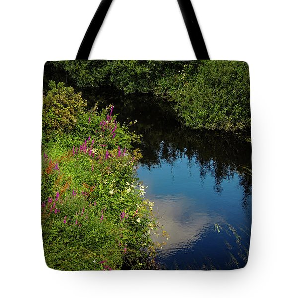 Tote Bag featuring the photograph A Serene Scene In The Magical Irish Countryside by James Truett