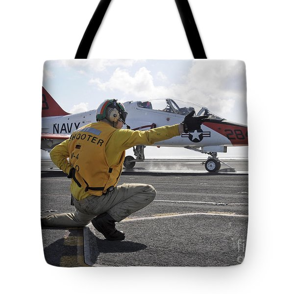 A Shooter Launches A T-45 Goshawk Tote Bag by Stocktrek Images