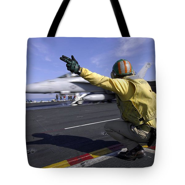A Shooter Signals The Launch Of An Tote Bag by Stocktrek Images