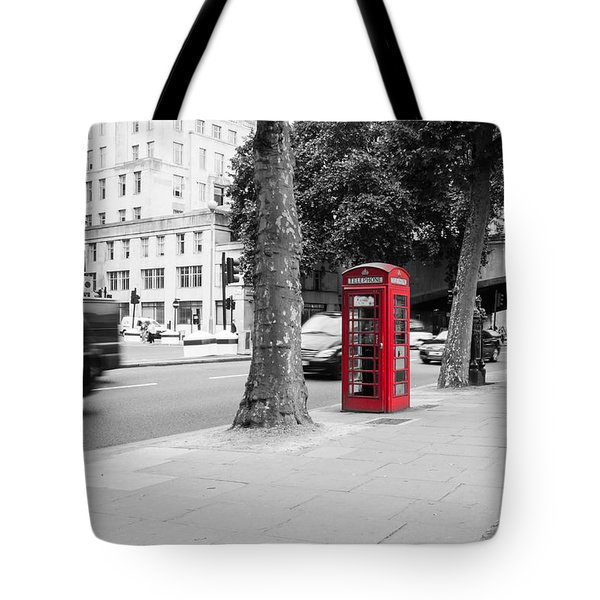 A Single Red Telephone Box On The Street Bw Tote Bag