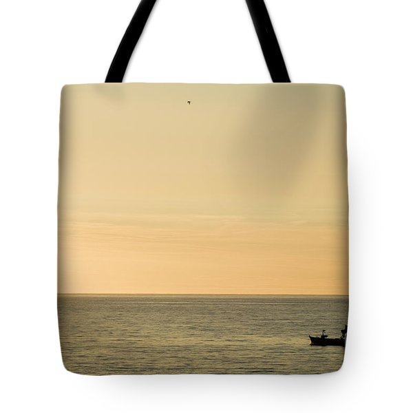 A Small Fishing Boat In Sunset Over Cardigan Bay Aberystwyth Ceredigion West Wales Tote Bag