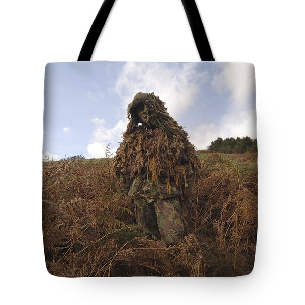 A Sniper Dressed In A Ghillie Suit Tote Bag by Andrew Chittock
