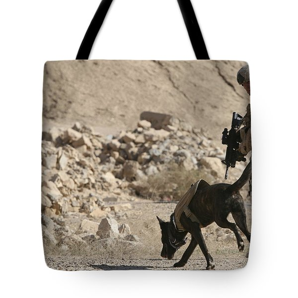 A Soldier And His Dog Search An Area Tote Bag by Stocktrek Images