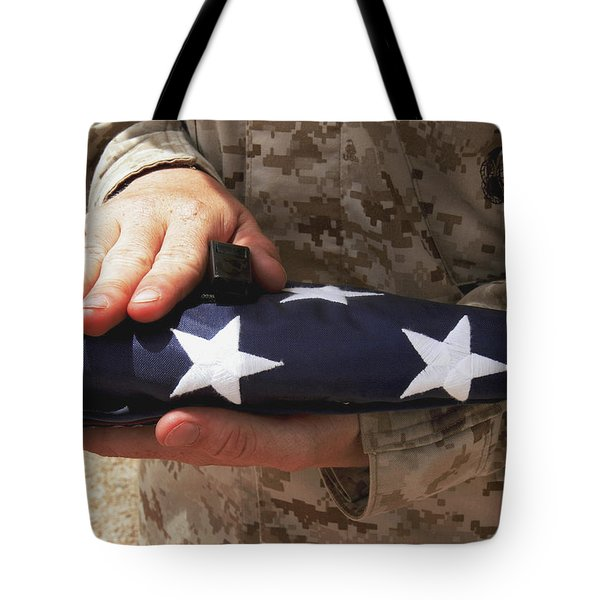 A Soldier Holds The United States Flag Tote Bag by Stocktrek Images