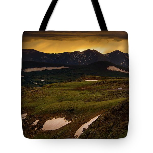 Tote Bag featuring the photograph A Stormy Alpine Sunset by John De Bord