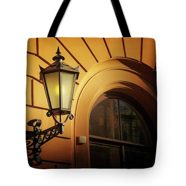 Tote Bag featuring the photograph A Street Lamp In Lisbon Portugal  by Carol Japp
