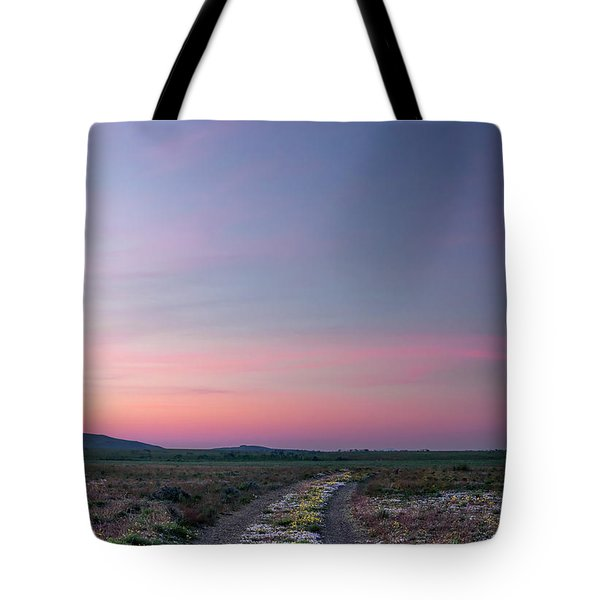 A Sunrise Path Tote Bag by Leland D Howard
