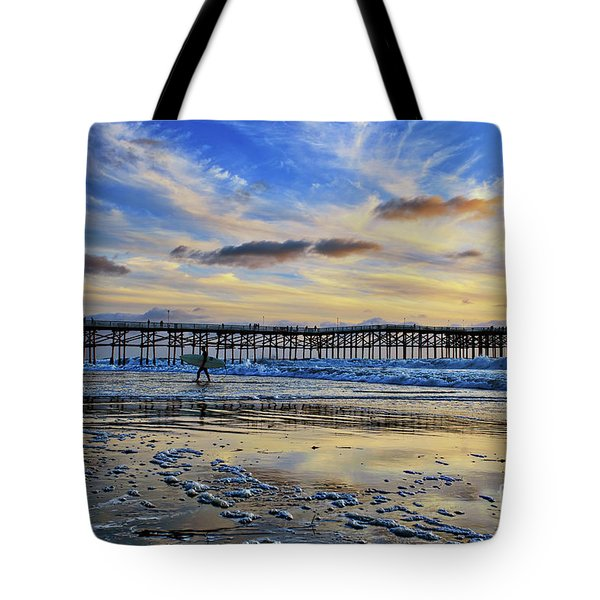 A Surfer Heads Home Under A Cloudy Sunset At Crystal Pier Tote Bag