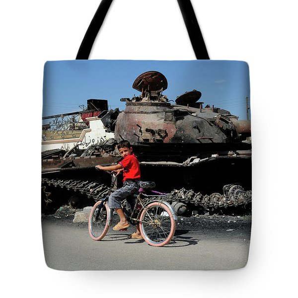 A Syrian Boy On His Bicycle In Front Tote Bag by Andrew Chittock