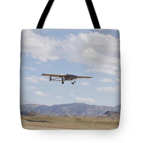 A Tiger Shark Unmanned Aerial Vehicle Tote Bag by Stocktrek Images