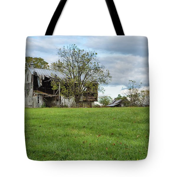 Tote Bag featuring the photograph A Tired Old Barn by John M Bailey