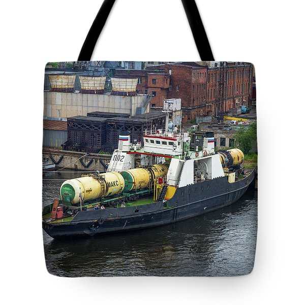 Tote Bag featuring the photograph A Train Ferry In St Petersburg Carrying Freight by Clare Bambers
