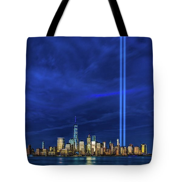 Tote Bag featuring the photograph A Tribute At Dusk by Chris Lord