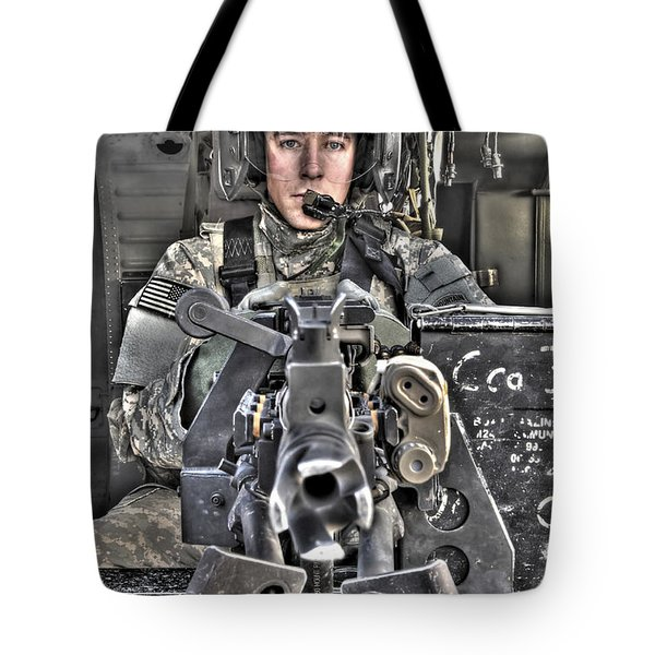 A Uh-60 Black Hawk Door Gunner Manning Tote Bag by Terry Moore