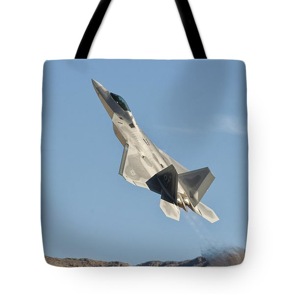 A U.s. Air Force F-22 Raptor Takes Tote Bag by Giovanni Colla
