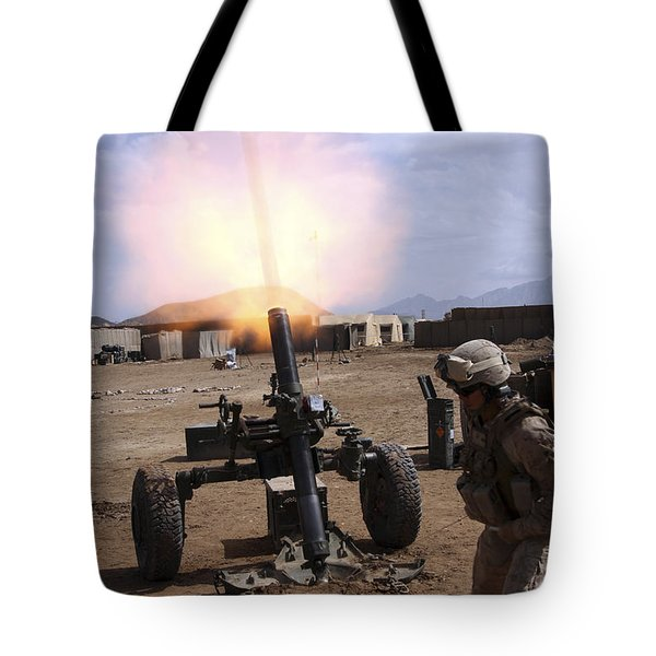 A U.s. Marine Corps Gunner Fires Tote Bag by Stocktrek Images