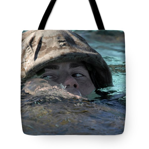 A U.s. Marine Swims Across A Training Tote Bag by Stocktrek Images