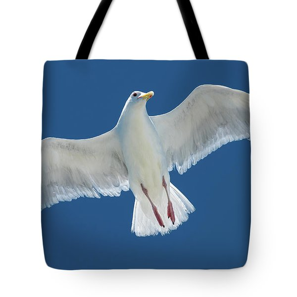 Tote Bag featuring the photograph A White Gull Flying In Sky by William Lee