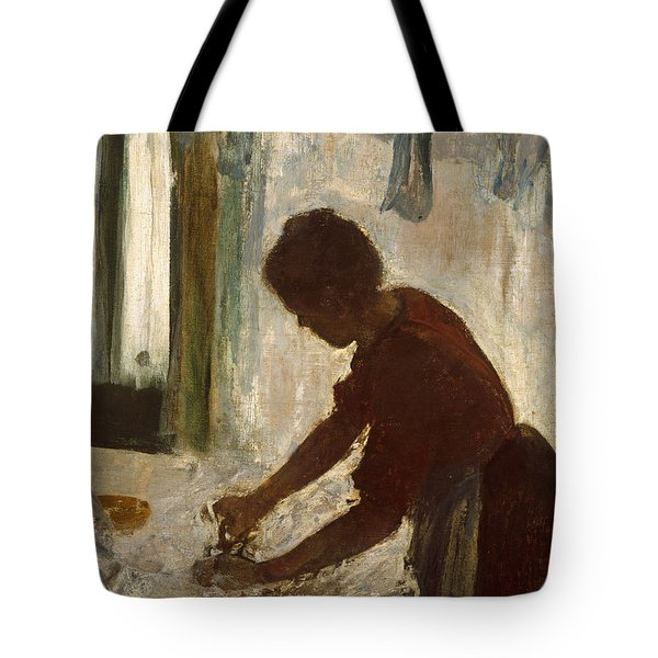 Tote Bag featuring the painting A Woman Ironing by Edgar Degas
