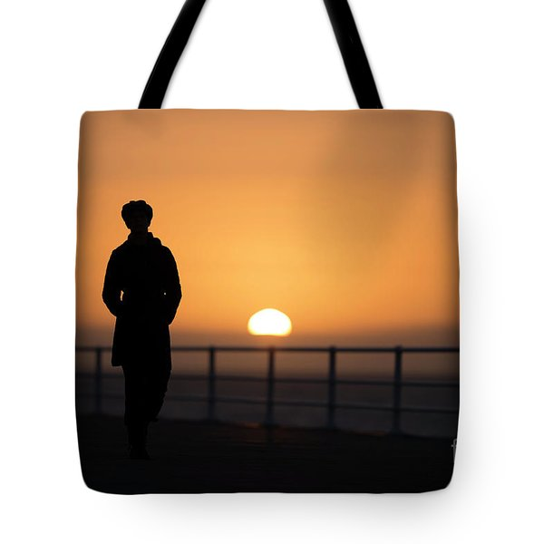 A Woman Silhouetted At Sunset Tote Bag