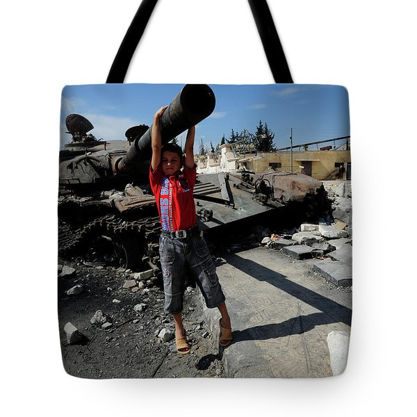 A Young Syrian Boy Plays On The Turret Tote Bag by Andrew Chittock