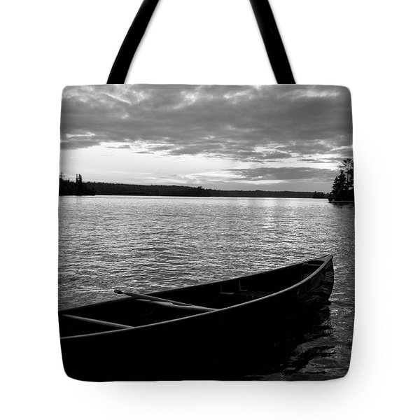 Abandoned Canoe Floating On Water Tote Bag by Keith Levit