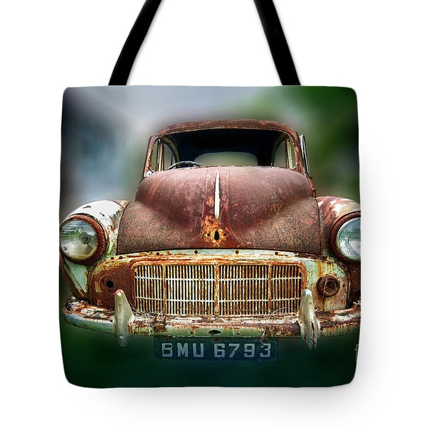 Tote Bag featuring the photograph Abandoned Car by Charuhas Images
