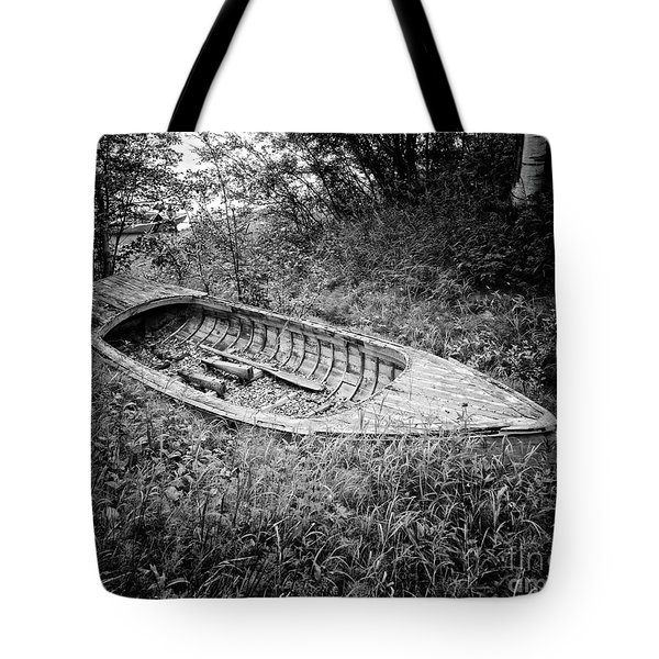 Tote Bag featuring the photograph Abandoned Wooden Boat Alaska by Edward Fielding