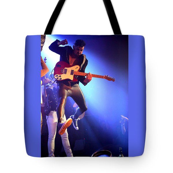 Tote Bag featuring the photograph Adam Catches Some Air by John King