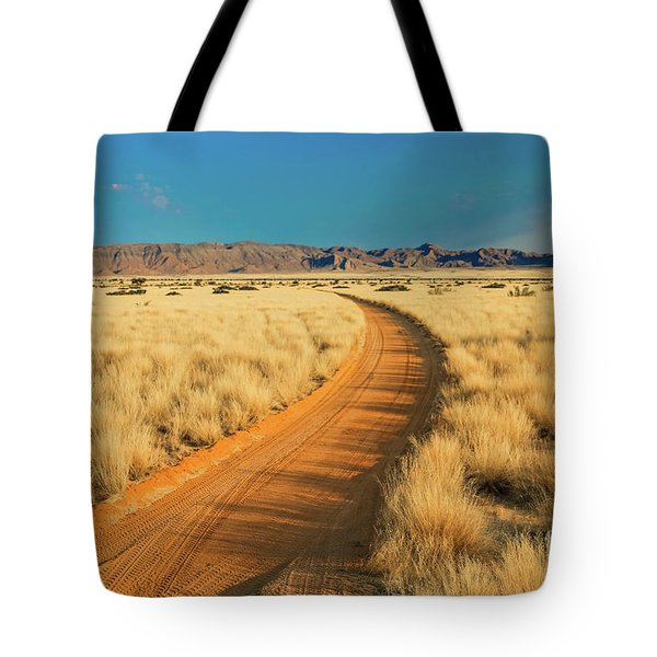 Tote Bag featuring the photograph African Sand Road by Benny Marty