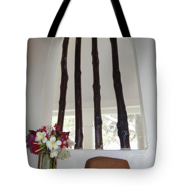 African Table With Flowers And Hat Tote Bag