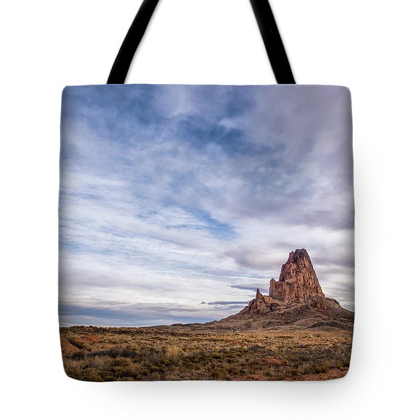 Tote Bag featuring the photograph Agathla Wakes Up by Jon Glaser