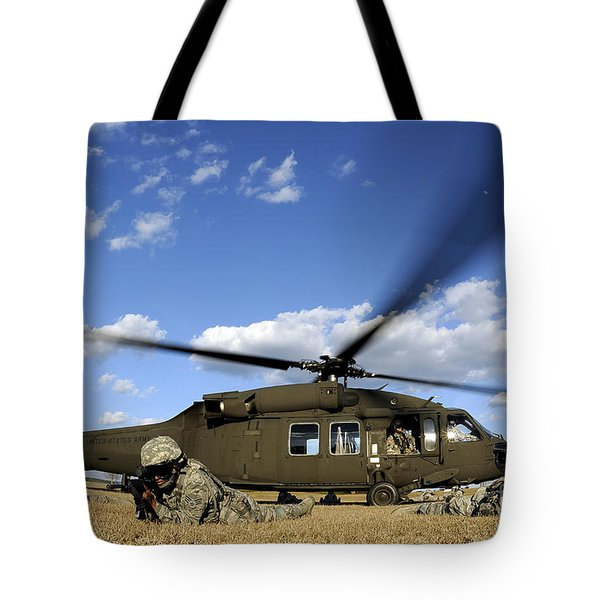 Airmen Provide Security In Front Tote Bag by Stocktrek Images