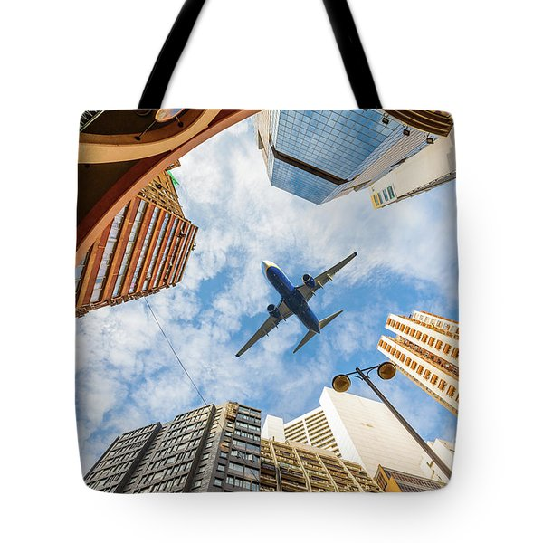 Airplane Above City Tote Bag