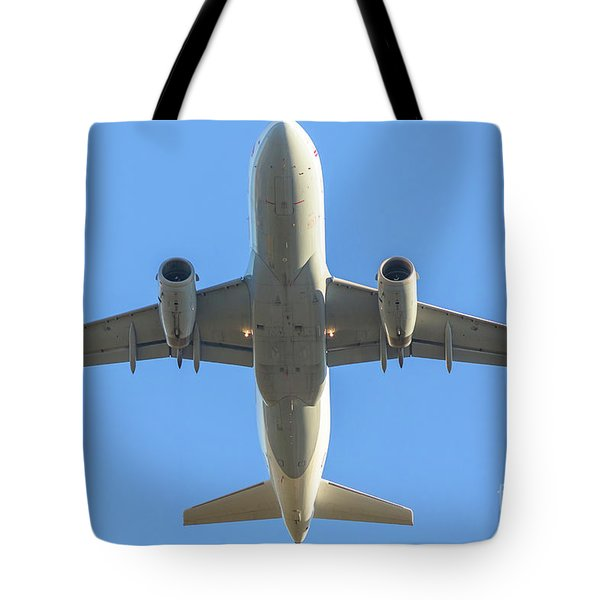 Airplane Isolated In The Sky Tote Bag