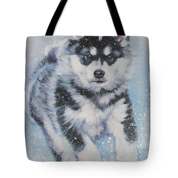 alaskan Malamute pup in snow Tote Bag by Lee Ann Shepard