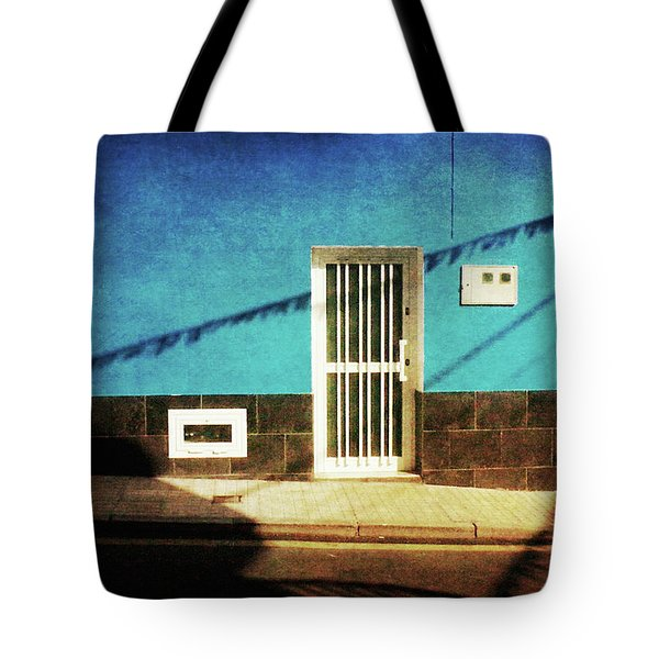 Tote Bag featuring the photograph Alcala Blue Wall White Door by Anne Kotan