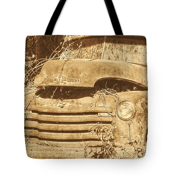 Tote Bag featuring the photograph All Used Up by Victor Montgomery
