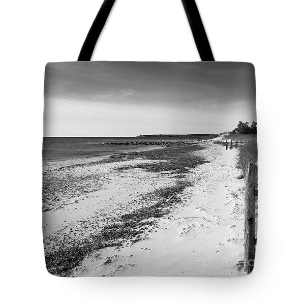 Tote Bag featuring the photograph Alone by Michelle Wiarda