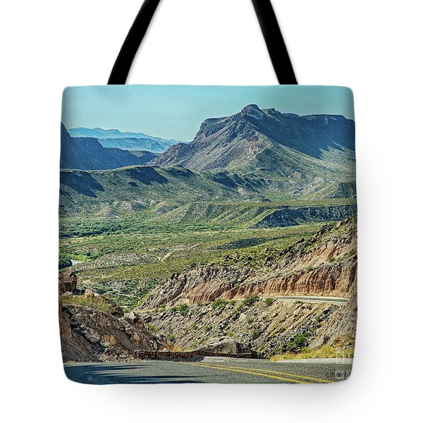 Tote Bag featuring the photograph Along The Border by Charles McKelroy
