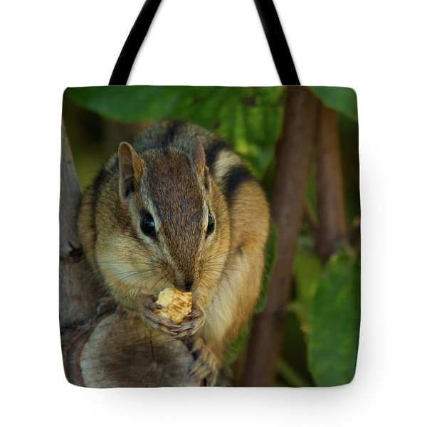 Tote Bag featuring the photograph Alvin Eating 1 by Brian Hale