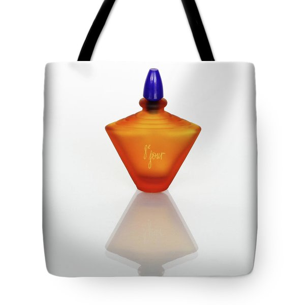 Tote Bag featuring the photograph Amber Perfume Bottle by David and Carol Kelly