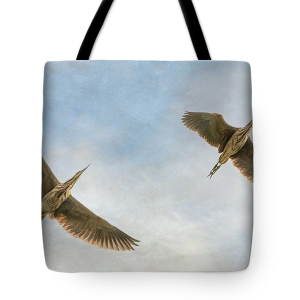 Tote Bag featuring the photograph American Bitterns In Flight by Angie Vogel