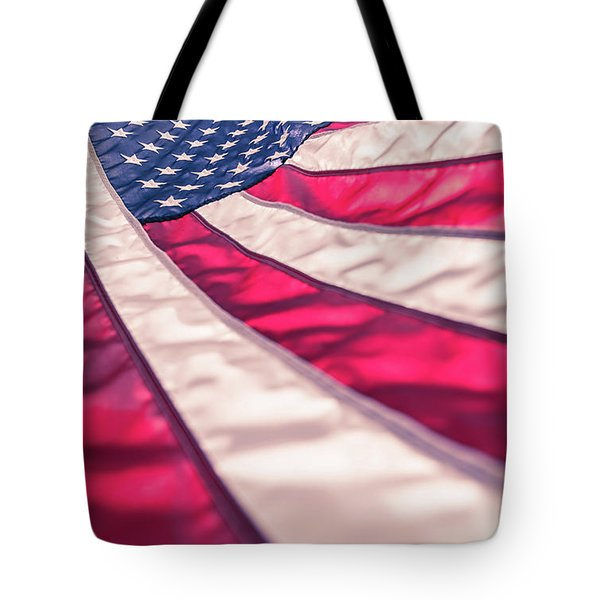 Tote Bag featuring the photograph American Flag In Red White Stripe,stars And Blue Symbolic Of Pat by Jingjits Photography