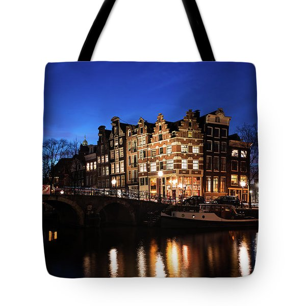 Tote Bag featuring the photograph Amsterdam Canal Houses Illuminated At Dusk by IPics Photography